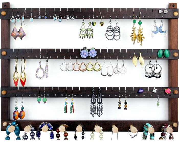 """""""Seriously, I wish I would've invested in a huge ass earring holder sooner in my life. If you're like me and have a million and one holes in ears and face, it's seriously nice to have something to put them in and keep them organized."""" —brandyh46115f7e8Get your jewels in order with a holder here."""