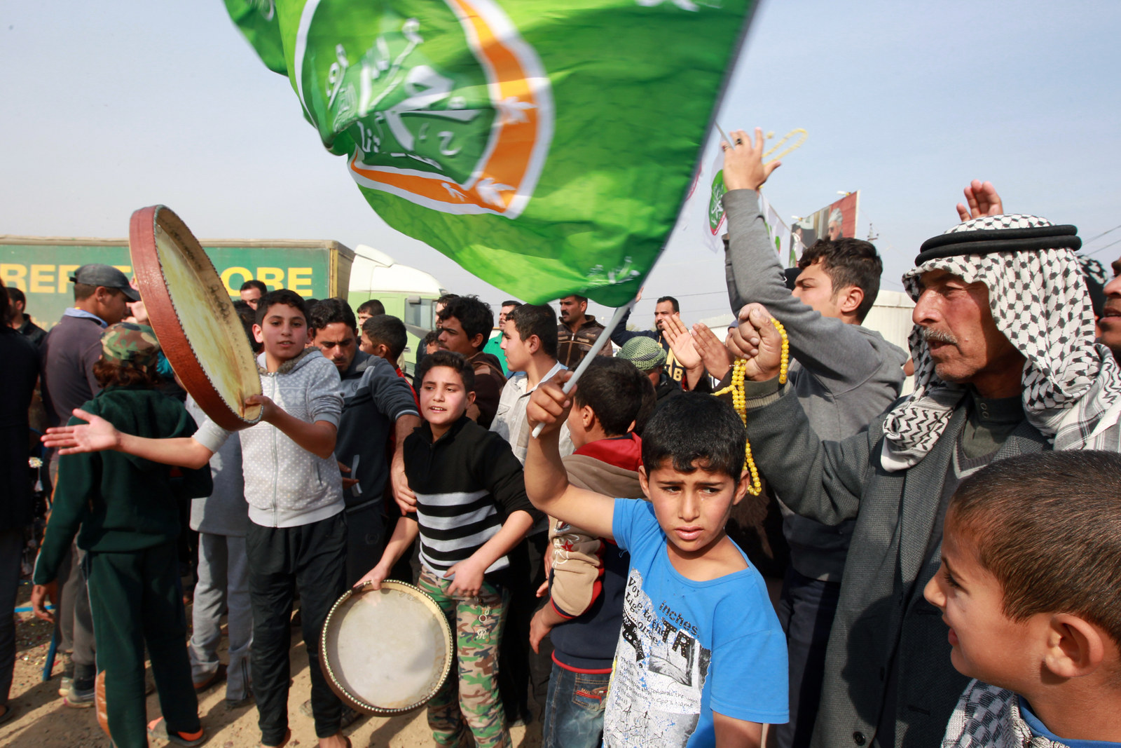 Displaced Ramadi residents celebrate at the Alkzenzanah camp in the capital Baghdad