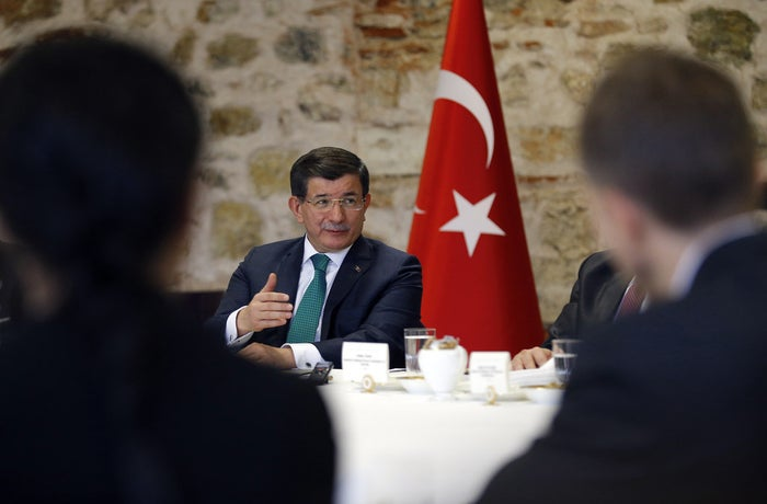 Turkish Prime Minister Ahmet Davutoglu speaks to a group of foreign reporters in Istanbul
