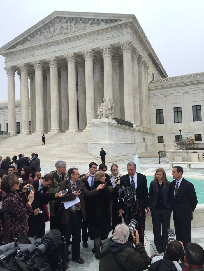 Abigail Fisher, second from right, speaks to reporters after her case was heard a second time at the Supreme Court on Dec. 9, 2015.