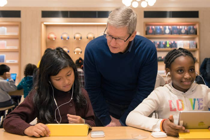 Tim Cook photographed at the Apple Store in NYC with third graders from P.S. 57 in Harlem on Dec. 9, 2015.