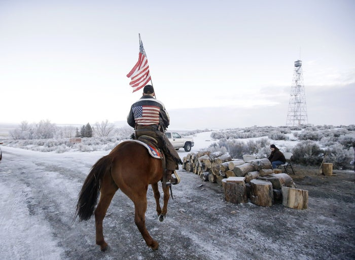 Dwane Ehmer, a supporter of the group occupying the Malheur National Wildlife Refuge, rides his horse Friday near Burns, Oregon.
