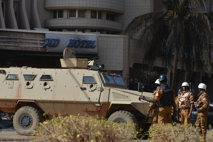 Burkina Faso troops stand guard outside the Splendid hotel and the nearby Cappuccino restaurant