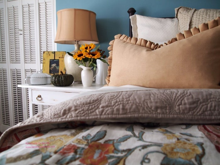 What's better than two pillows? Four pillows. (If you're loving the look, it does mean you might have to make up your bed to maintain that cozy factor.) See more of this autumn-inspired bed here.
