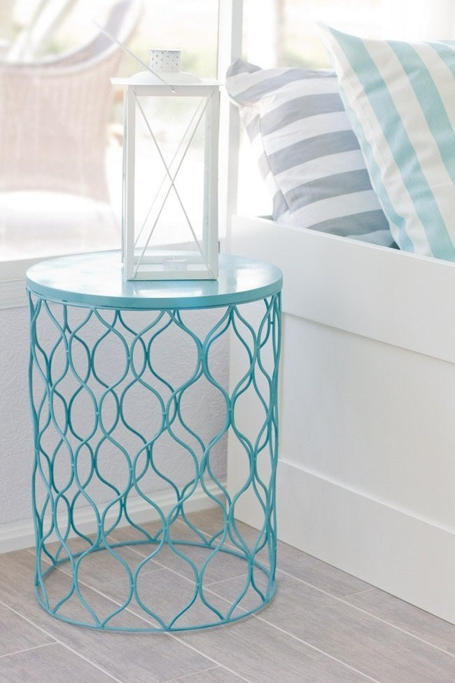 Just spray paint and turn upside down to add a pop of color and some extra table space to your room.