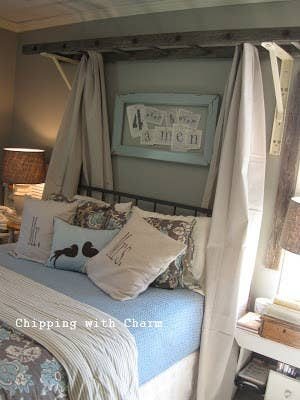 Transform a wooden ladder and some linen fabric into a rustic canopy.