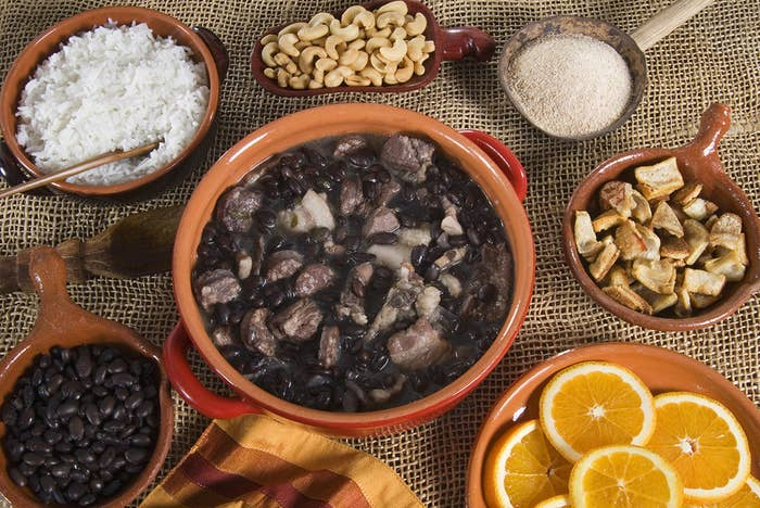 While originally a Portuguese recipe, Feijoada is the national dish of Brazil, and is a food coma–inducing mix of pork, beef, black beans, farofa, rice, pork rinds, and greens.It's only served on certain days of the week too. In São Paulo, it's eaten on Wednesday and Saturday, while in Rio, it's enjoyed for lunch on Friday and Saturday.