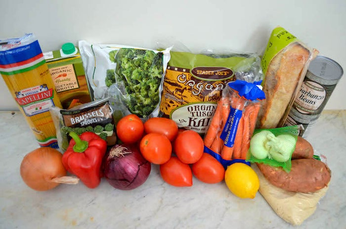 Here's what you'll need for a week of vegan dinners:* One package capellini (angel-hair) pasta* One carton vegetable broth* One 16-oz. bag frozen Brussels sprouts* One large yellow onion* One large red onion* Six Roma tomatoes* One lemon* One 16-oz. bag frozen broccoli* One 10-oz. bag kale* One 16-oz. bag carrots* Two heads garlic* Two large sweet potatoes* One package refrigerated pizza dough* Two cans chickpeas* One ciabatta rollIt might vary a little depending on where you live, but we got all this for less than $21. There are also a few ingredients you should already have on hand, such as olive oil, salt, pepper, and a few spices, including cumin and paprika.To make the whole process as simple and painless as possible, roast two trays of veggies on Sunday night. That way, these five dinners will take less than 20 minutes to prepare. Click here to find out how to roast the veggies.