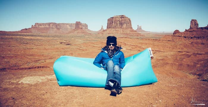When compressed, it fits in a little pouch and weighs two pounds. Inflated, it's about 6.5 feet long and three feet wide, which means it can probably fit one human lying down, and a few humans sitting down.