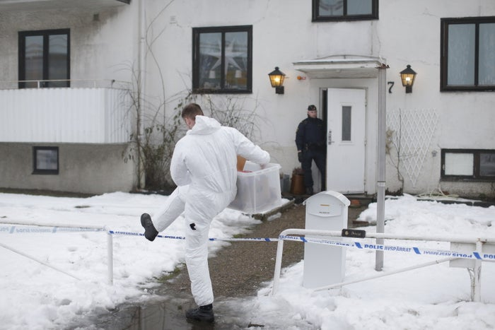 A forensic police officer carries a box of evidence at the migrant center in Molndal, Jan. 25.