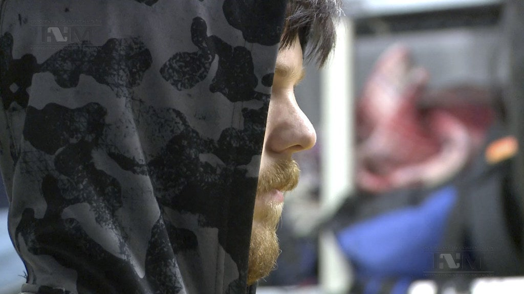 Ethan Couch waits as he is processed by Mexican immigration agents in Mexico City.