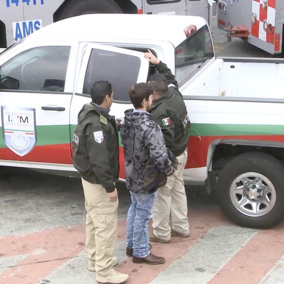 Ethan Couch escorted by Mexican immigration agents at the international airport in Mexico City.