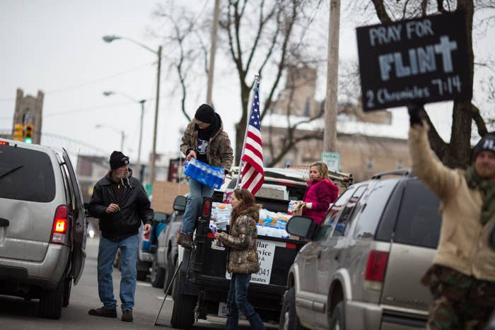 Protesters hand out water to Flint residents during a rally on Jan. 24, 2016 at City Hall.