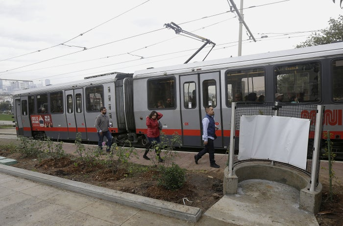 Passengers who exited a San Francisco MUNI streetcar walk past the outdoor urinal on Thursday.