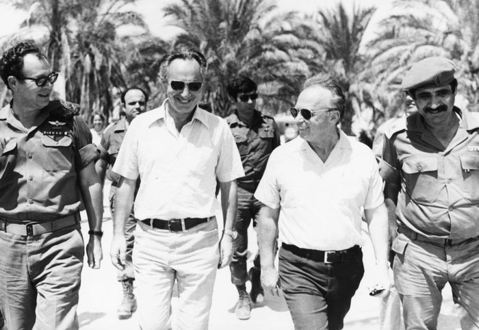 Israeli Prime Minister Yitzhak Rabin (second right) with Shimon Peres (second left) walk with IDF commanders during the 1967 war.