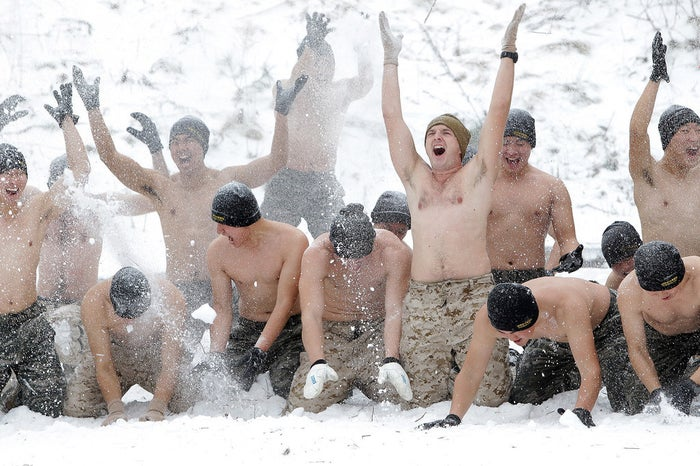 U.S. Marines from 3rd Marine Expeditionary force cover themselves in snow with South Korean marines during a winter military training exercise in Pyeongchang-gun, South Korea.