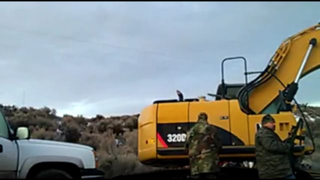 A screenshot from Fry's YouTube account shows two men at the refuge site on Thursday.