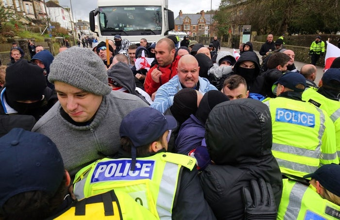 Right-wing protestors push through police lines.