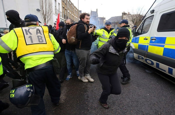 Anti-fascist protesters break through police lines during the demonstrations.
