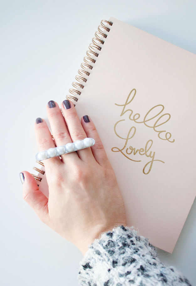 Upgrade your pearls with this popsicle stick statement ring: