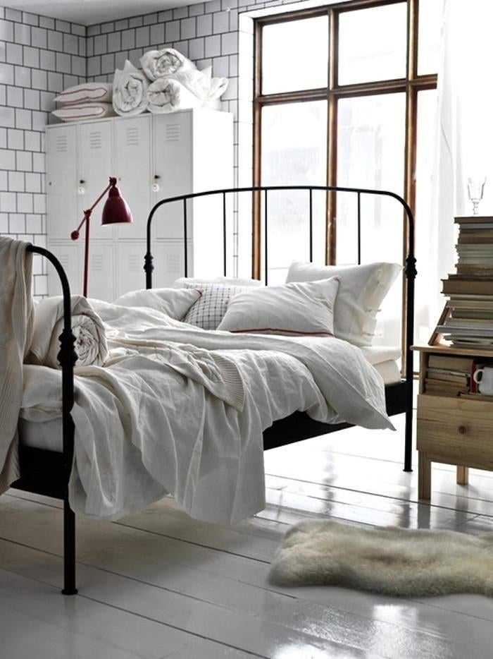 If you have a fairly large room, your bed doesn't need to lean up against the wall. If you add some space between the bed and the window, you'll create a cozy reading spot.