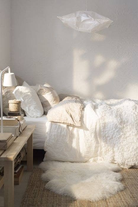 18  Add a fuzzy throw for a luxurious touch. 21 Inexpensive Ways To Upgrade Your Bedroom