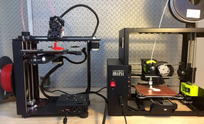 The MakerGear M2 (left) and LulzBot Mini (right) in action.