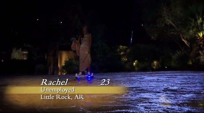 """Rachel enters on a hoverboard-razor-scooter-thing-whatever and it's truly one of the lamest things I've seen in all my years of watching this show. Her dress, while sequined (you can see the glimmer in Ben's eye!) is ugly, frankly, and it also has a cape attached to the back? """"Unemployed,"""" indeed."""