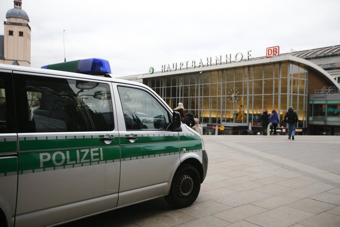 A police vehicle patrols the main square in Cologne.