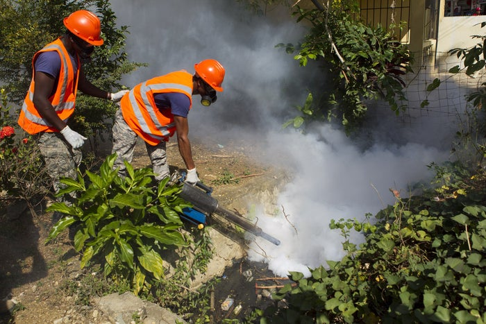 Dominican Air Force personnel fumigate various locations in Santo Domingo against the Aedes aegypti mosquito