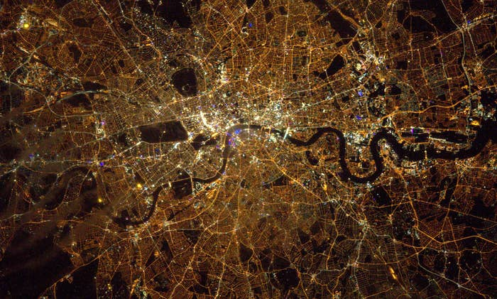 """When he uploaded the photo to Flickr, he captioned it: """"London midnight Saturday - I'd rather be up here…but only just!!"""""""