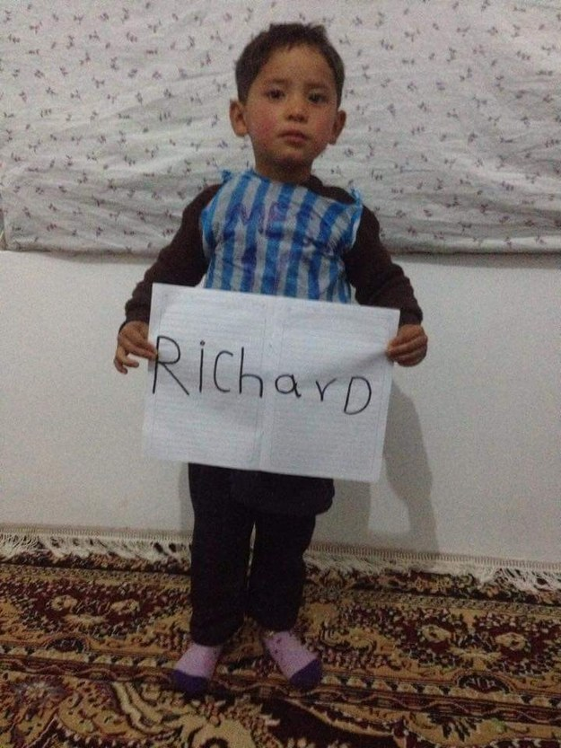 """After a week of searching, I was put in contact with an """"Ahmadi"""" family in eastern Afghanistan, who claimed to be the child's family. As proof, they sent me an image of the boy wearing the plastic bag and holding up a sign on which he had written my name."""
