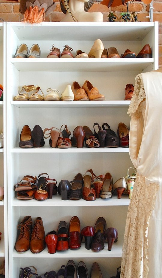 This is the relatively affordable ($79.99) Billy Bookcase from Ikea. While this won't work so well in a tiny closet, it is an budget-friendly way to make a large closet more functional. Here's more Billy closet inspiration.