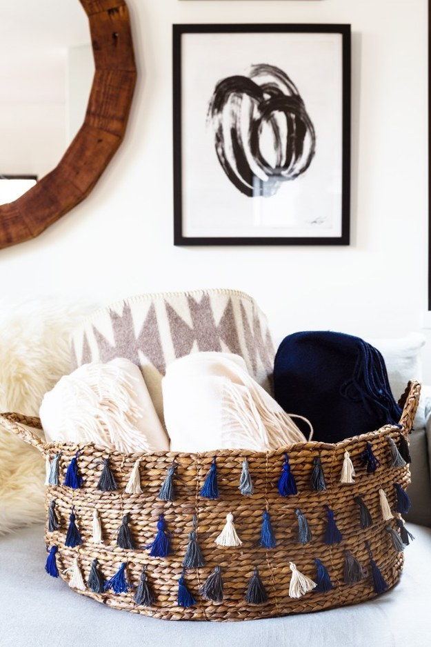 Reinvent a plain woven basket by adding some tassels.