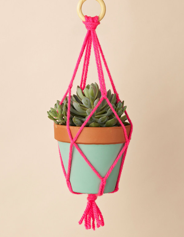 Speaking of macrame, display your plants with a neon macrame holder.