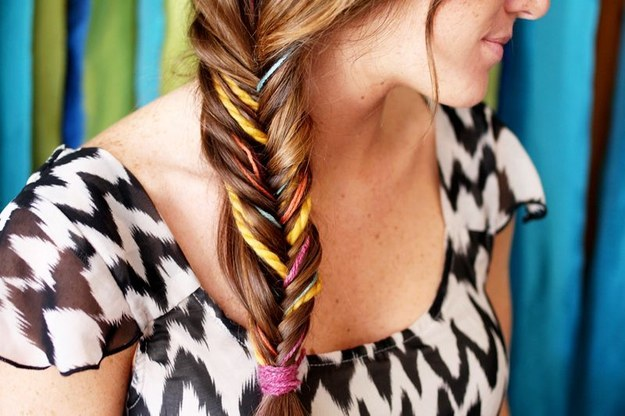Jazz up a braid with some colored yarn.