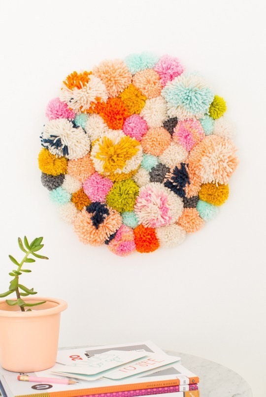 Bundle up some pom-poms to create this textured decoration.