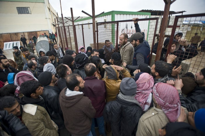 Syrians who fled the bombing in Aleppo try to get into a tent city on their way to the Bab al-Salam crossing across the border from Turkey.
