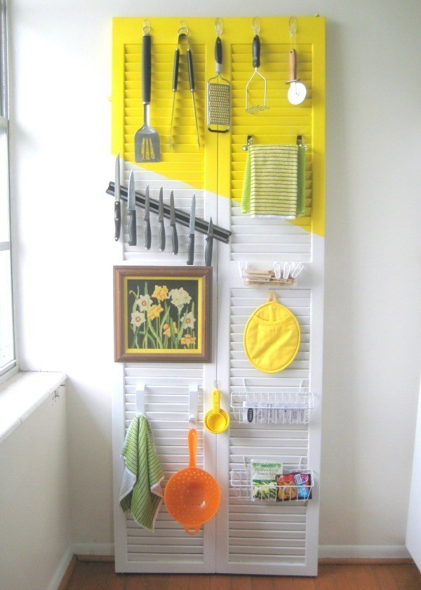 If you want more storage without having to sacrifice floor space, turn an old door into an easy-access kitchen organizer.