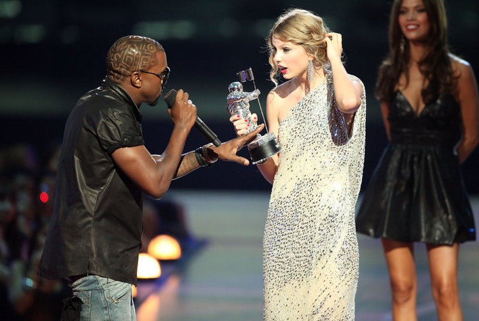 West jumps onstage after Swift won the Best Female Video award during the 2009 MTV Video Music Awards.