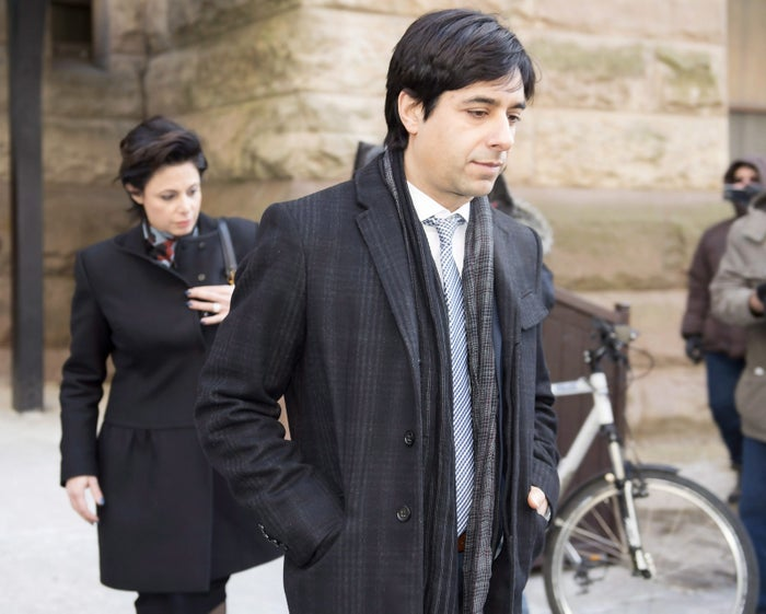 Jian Ghomeshi and his lawyer Marie Henein (left) leave court in Toronto following closing arguments in his sexual assault trial on Thursday, Feb. 11, 2016.
