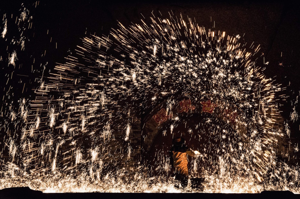 These photos capture the moment he hurls MOLTEN IRON at a cold concrete wall. That's metal as hell, bro.