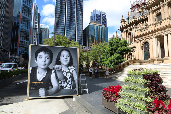 Seven enormous portraits of children who grew up in same-sex families are on display outside Sydney's Town Hall.