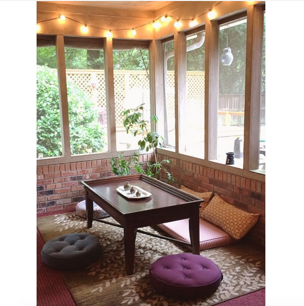 This big and bright sunroom that fits multiple meditation buddies: