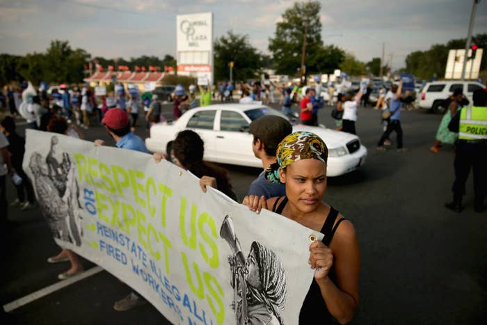 Demonstrators march and block traffic outside a Walmart store in 2013.