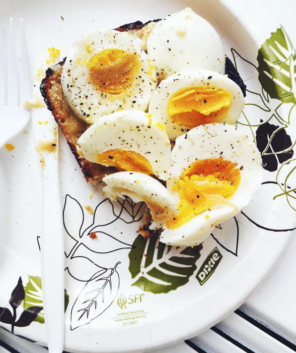 Hard-boiled eggs are cheap, healthy, and easy, but they can get boring. Serve them on toast with a little bit of butter to make things more exciting.