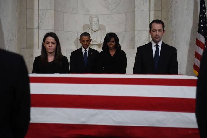 President Obama and First Lady Michelle Obama pay their respects.