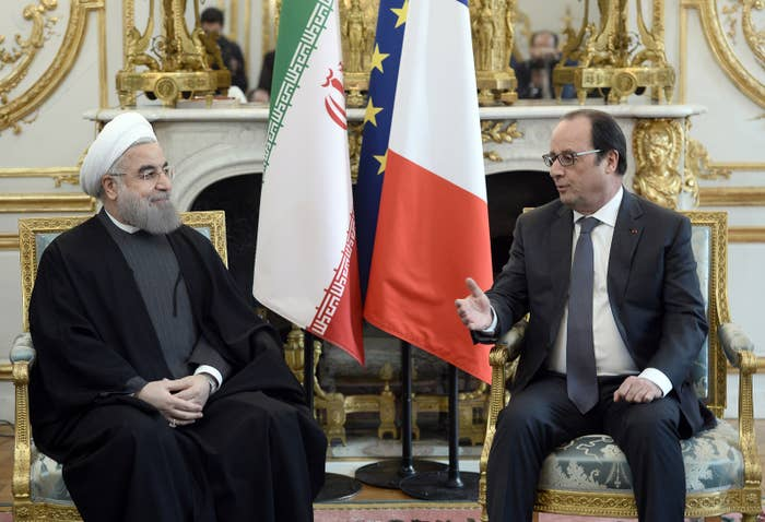 French president Francois Hollande speaks with Iranian President Hassan Rouhani