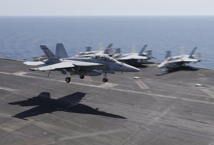 U.S. warplanes land on an aircraft carrier in the Gulf, Jun. 2015.