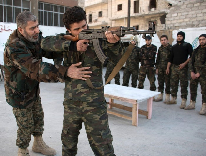 New recruits take part in a training session at a camp in a rebel-held area of Aleppo before fighting along with opposition fighters.